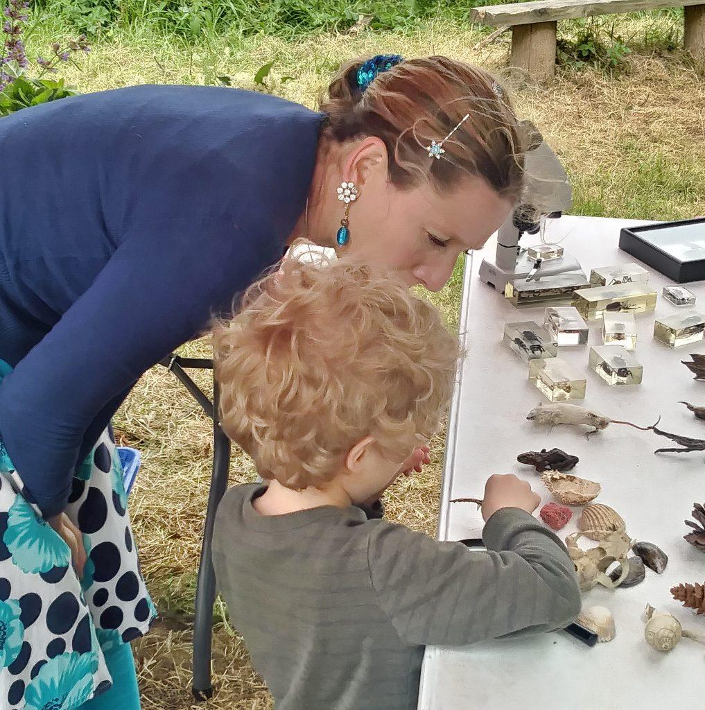 Lizzie teaching achild at Hay festival